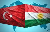 Waving Kurdish and Turkish flags — Stock Photo