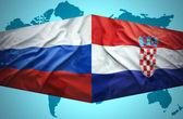 Waving Croatian and Russian flags — Stock Photo