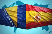 Waving Bosnian and Spanish flags — Stock Photo