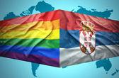 Waving Serbian and Gay flags — Stock Photo