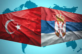 Waving Serbian and Turkish flags — Stock Photo