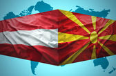 Waving Macedonian and Austrian flags — Stock Photo