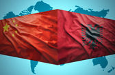 Waving Albanian and Chinese flags — Stock Photo