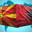 Постер, плакат: Waving Albanian and Macedonian flags