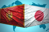 Waving Montenegrin and Japanese flags — Stock Photo