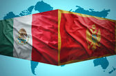Waving Montenegrin and Mexican flags — Stock Photo