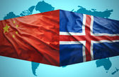 Waving Icelandic and Chinese flags — Stock Photo