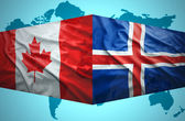 Waving Icelandic and Canadian flags — Stock Photo
