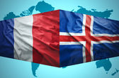 Waving Icelandic and French flags — Stock Photo