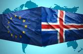 Waving Icelandic and European Union flags — Stock Photo