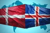 Waving Icelandic and Danish flags — Stock Photo