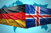 Waving Icelandic and German flags — Stock Photo