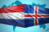 Waving Icelandic and Dutch flags — Stock Photo