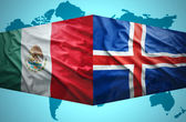 Waving Icelandic and Mexican flags — Stock Photo