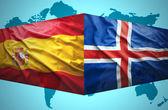 Waving Icelandic and Spanish flags — Stock Photo