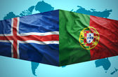 Waving Icelandic and Portuguese flags — Stock Photo