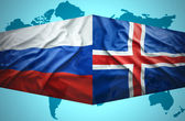 Waving Icelandic and Russian flags — Stock Photo