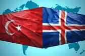 Waving Icelandic and Turkish flags — Stock Photo