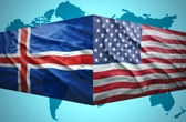 Waving Icelandic and American flags — Stock Photo