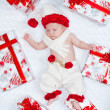 Newborn baby boy Santa Claus with Christmas gifts — Stock Photo #13244002