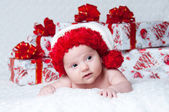 Newborn baby boy Santa Claus with Christmas gifts — Stock Photo