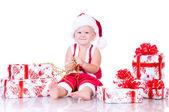 Niño regalos de papá noel con la navidad en un fondo blanco — Foto de Stock