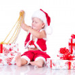 Stock Photo: Little boy Santa Claus with Christmas gifts on a white backgroun
