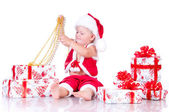 Little boy Santa Claus with Christmas gifts on a white backgroun — Stock Photo