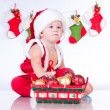 Royalty-Free Stock Photo: Cute baby Santa Claus with garlands and a basket of Christmas to