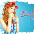 Stock Photo: Cute Lovely redhead pin-up girl drinks drink from tube