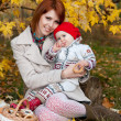Stock Photo: Happy family, mother and little daughter in autumn park