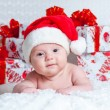 Stock Photo: Newborn baby boy SantClaus with Christmas gifts