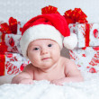 Stock Photo: Newborn baby boy Santa Claus with Christmas gifts