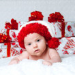 Newborn baby boy Santa Claus with Christmas gifts — Stock Photo #14699629