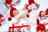 Newborn baby boy Santa Claus with Christmas gifts — Photo