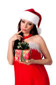 Beautiful brunette Santa Girl guesses gift — Zdjęcie stockowe