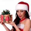 Beautiful brunette Santa Girl  happily looking at Christmas gift — Stock Photo