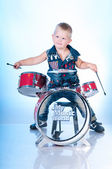 Cute boy playing the drums — Stock Photo