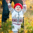 First steps. Little cute baby girl learning to walk — Stock Photo
