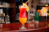 Tequila Sunrise cocktail at the bar. — Stock Photo