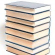 Foto Stock: A stack of books on a white background.
