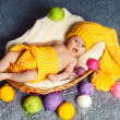 Stock Photo: Cute infant baby inside wicker basket