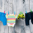 Stock Photo: Baby clothes hanging on clothesline.