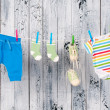 Baby clothes hanging on the clothesline. - 图库照片