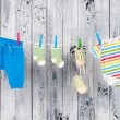 Baby clothes hanging on the clothesline. - Stock fotografie