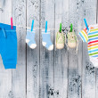 ストック写真: Baby clothes hanging on the clothesline.