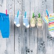 Foto de Stock  : Baby clothes hanging on the clothesline.