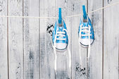Baby shoes hanging on the clothesline. — Stock Photo