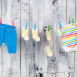 Baby clothes hanging on the clothesline. — Stock Photo #23889501