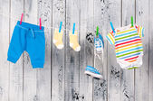 Baby clothes hanging on the clothesline. — Stock Photo